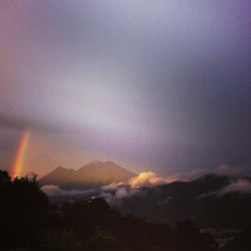 An early morning rainbow arching over the volcanoes of Antigua