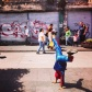 A child street performer acting out fight scenes for money in Guatemala City
